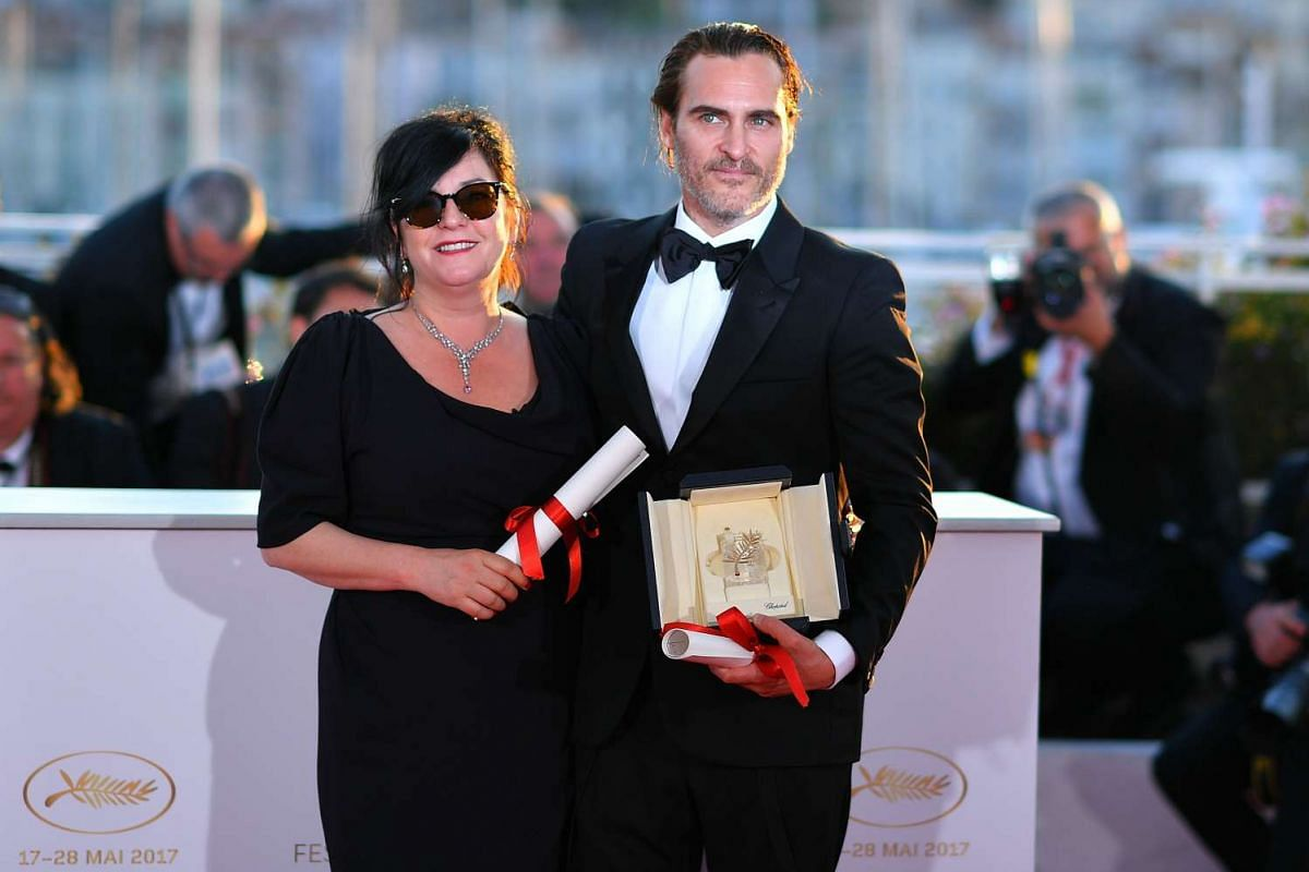 Best Screenplay co-laureate Lynne Ramsay with Best Actor Joaquin Phoenix, who won for his role in the film You Were Never Really Here.