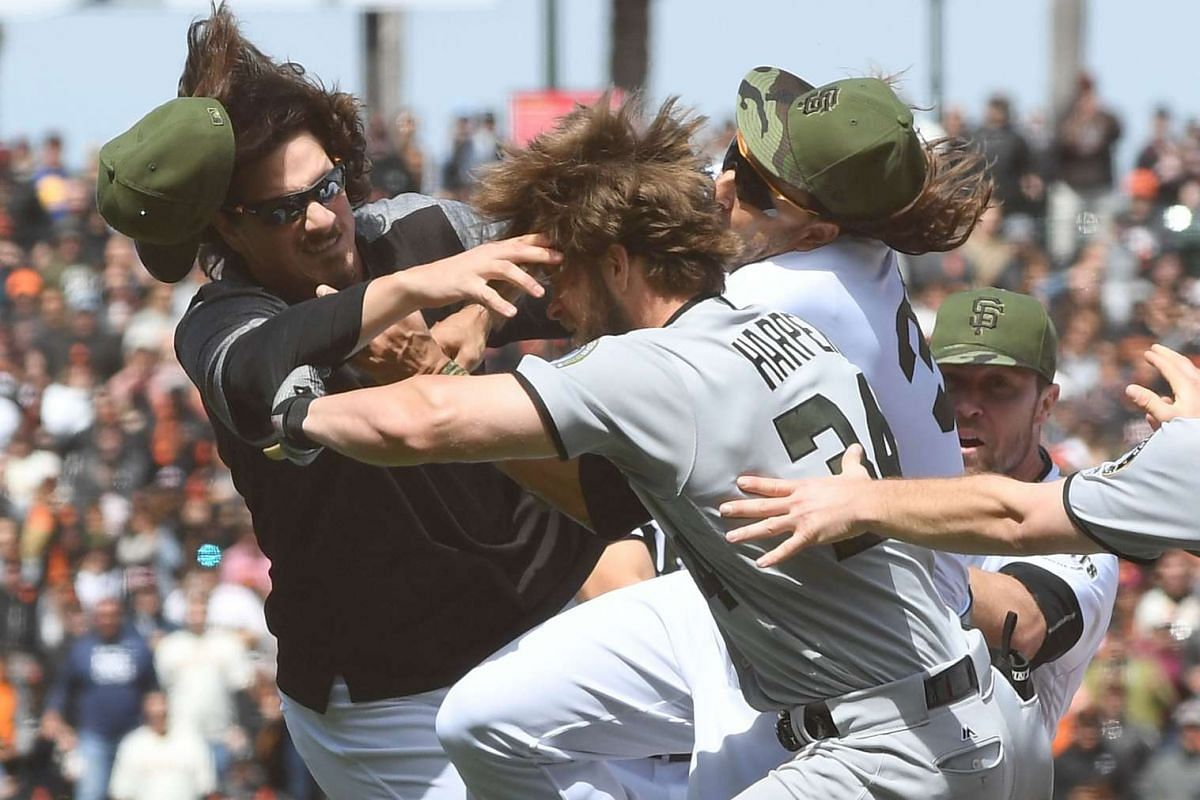 Jeff Samardzija #29 of the San Francisco Giants goes after Bryce Harper #34 of the Washington Nationals after Harper charged the mound from being hit by a pitch from Hunter Strickland #60 in the top of the eighth inning at AT&T Park on May 29, 2017 i