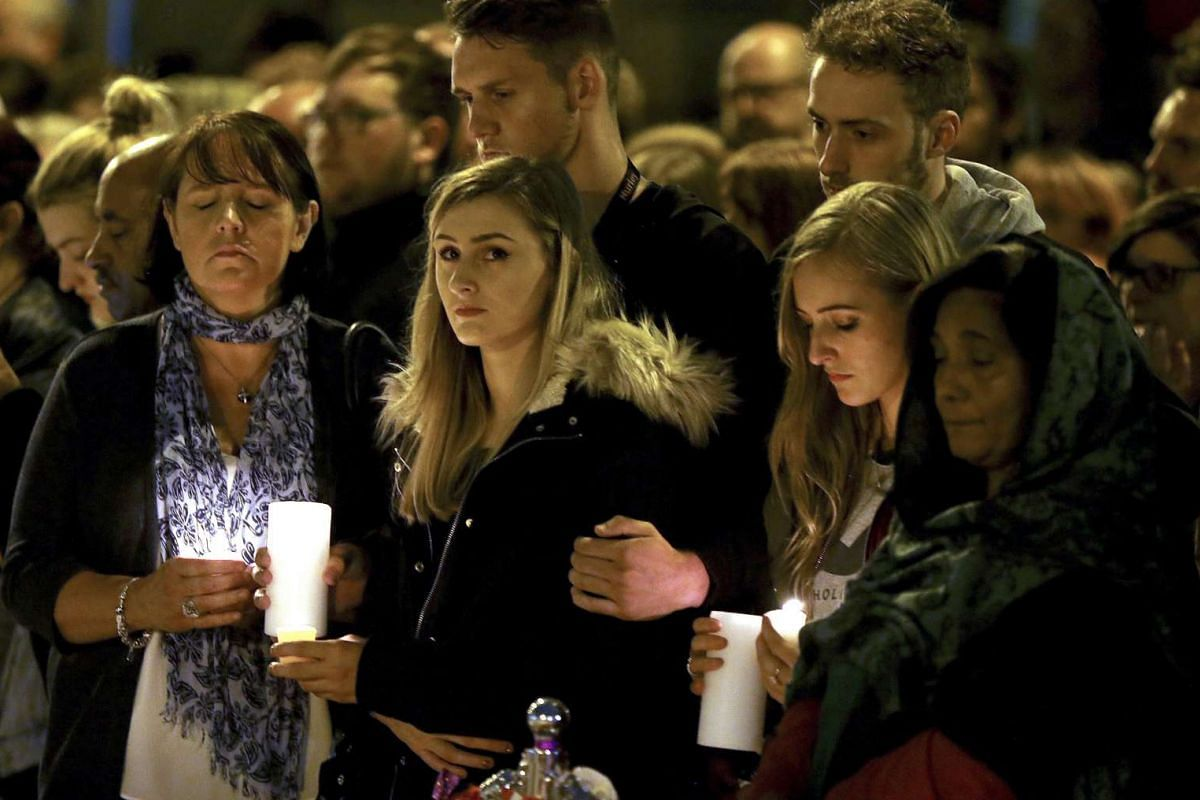 People paying their respects for the victims of the Manchester bombing during a vigil at 10.31pm in St Ann's Square in Manchester, Britain, on May 29, 2017.