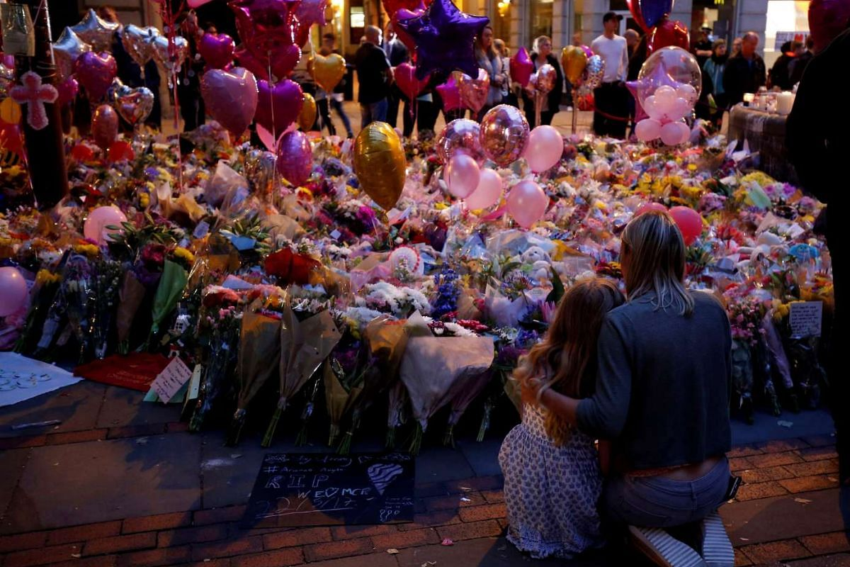 People attending a vigil for the victims of last week's attack at a concert at Manchester Arena, Britain, on May 29, 2017.