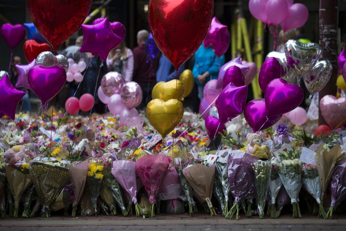 Balloons and flowers are pictured before a vigil in St Ann's Square in Manchester, Britain, on May 29, 2017.