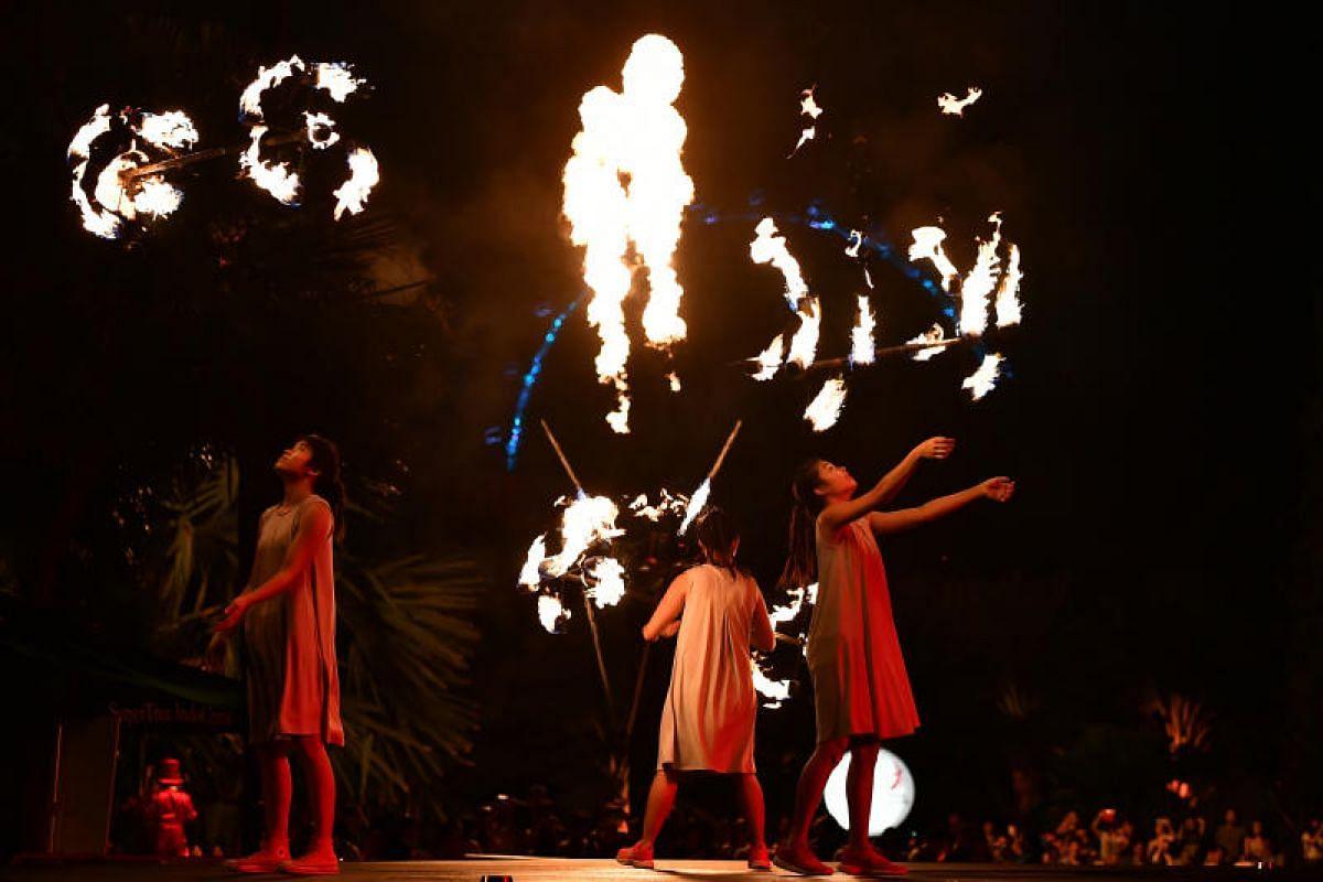 Fire twirlers add heat to the celebrations.