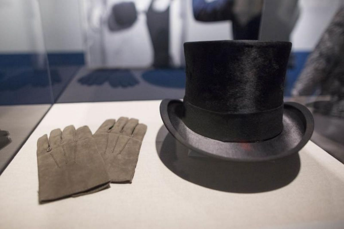 The hat and gloves worn by President John F. Kennedy at his inauguration, on display at the JFK 100: Milestones & Mementos exhibition at the John F. Kennedy Presidential Library on May 29, in Boston, Massachusetts.