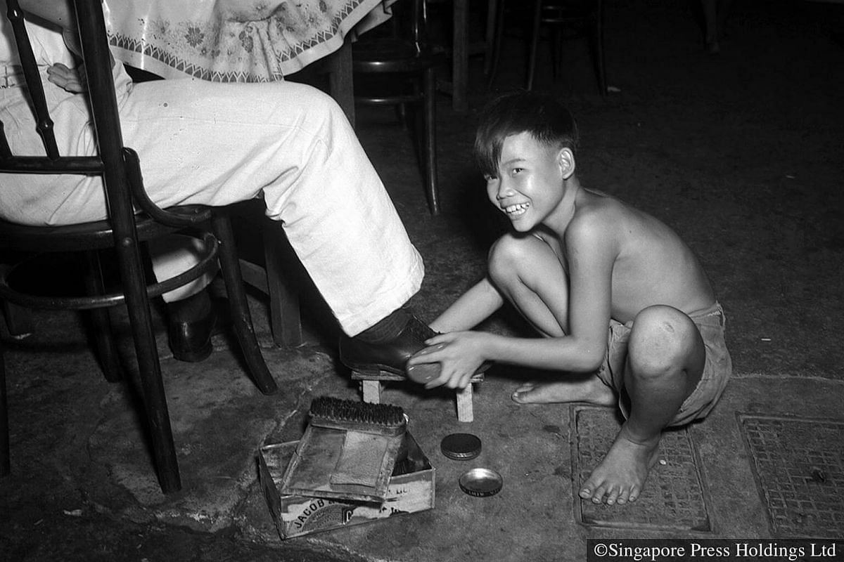 1952: Shoe-shining was a common job for young boys to help supplement their family's meager income.