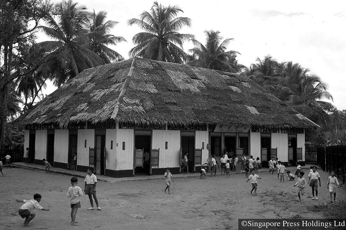 1950: School facilities were very basic - just a single storey wooden building and an outdoor play area.