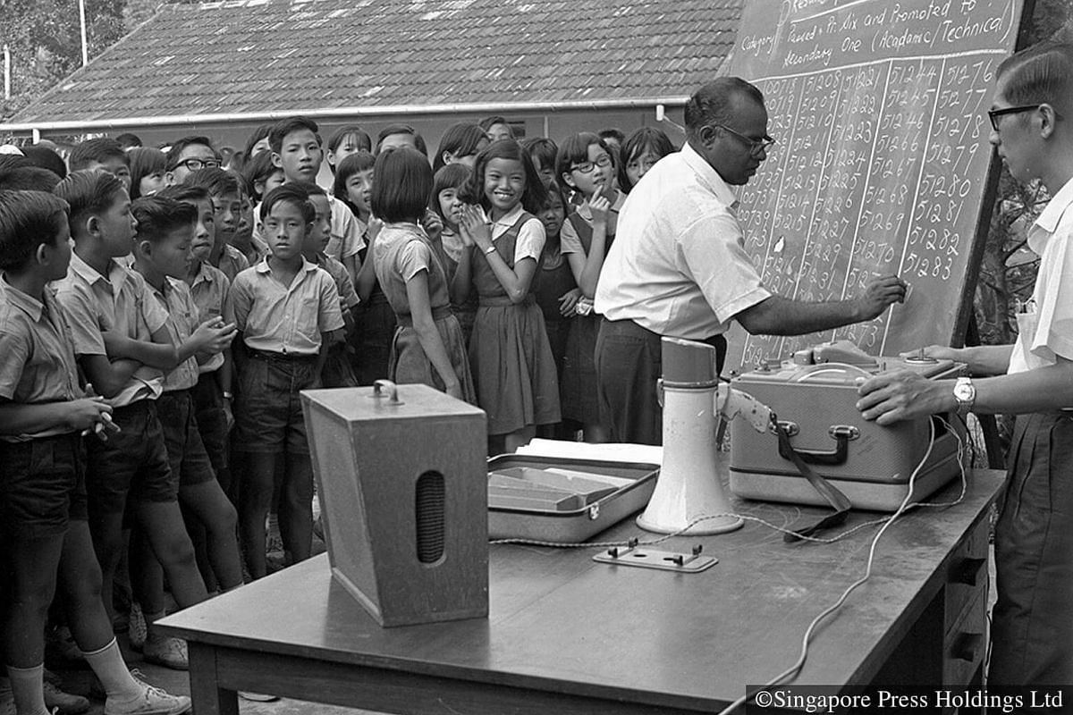 1967: Students anxiously waiting for their examination results at River Valley English School.