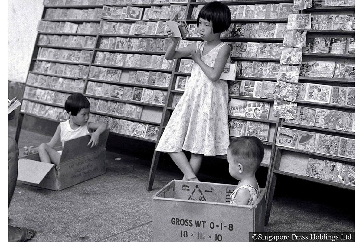 1958: Reading Chinese comic books at a five-foot-way library in Boon Tat Street.