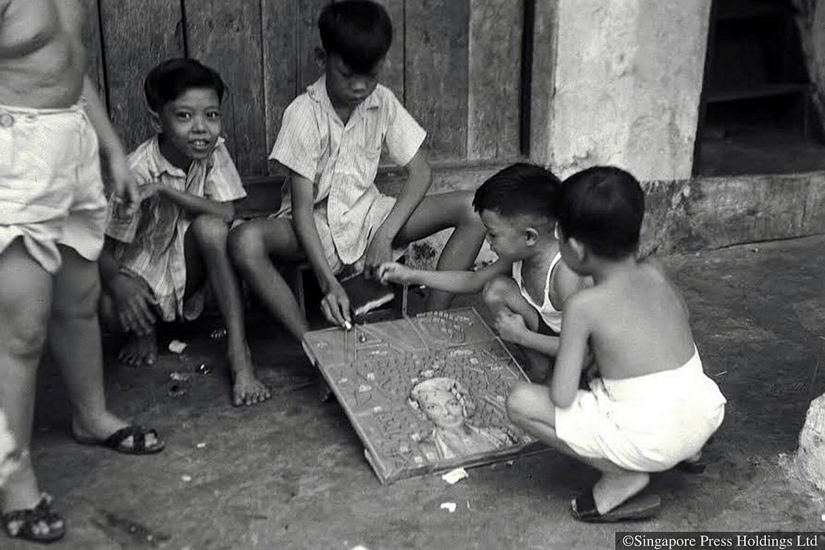 1952: Boys playing a board game.