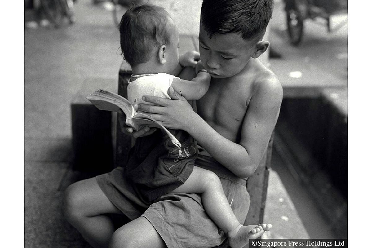 1958: For many families it was a common practice for older children to help look after their younger siblings.