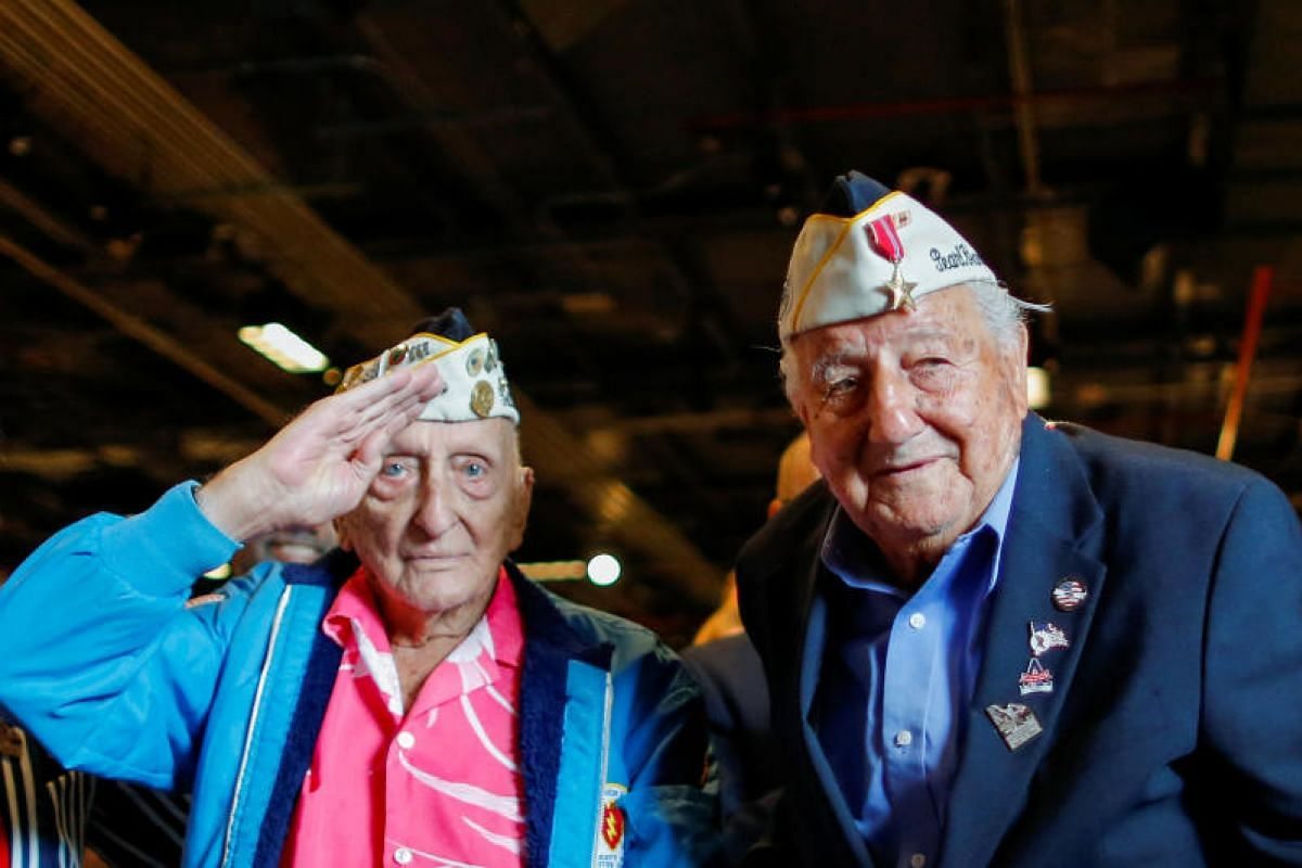 """World War II veterans and Pearl Harbor survivors John Seelie (left), 95, and Armando """"Chick"""" Gallela, 93, attending an annual Memorial Day commemoration ceremony at the Intrepid museum in New York on Monday (May 29). PHOTO: REUTERS"""