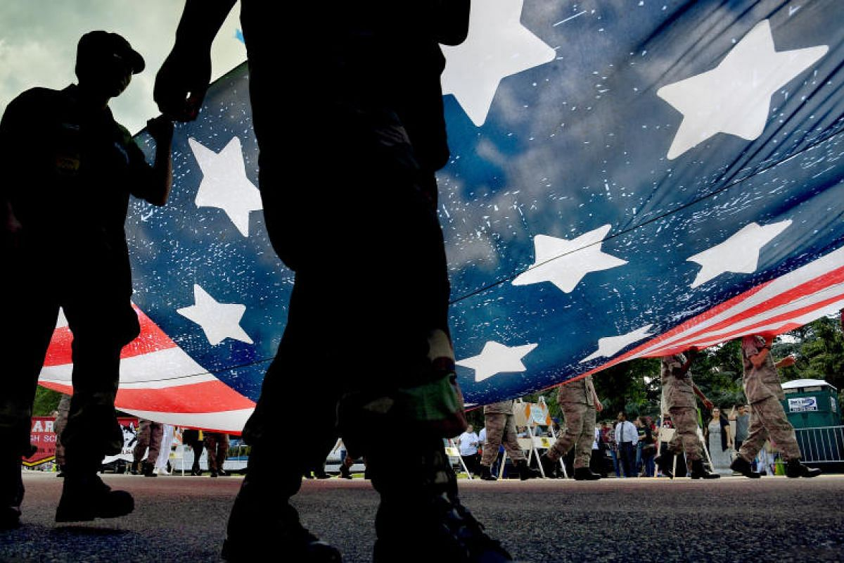 Members of the US Civil Air Patrol marching at the Memorial Day parade route on Monday (May 29), where thousands lined Constitution Avenue in Washington to watch the annual parade. PHOTO: WASHINGTON POST