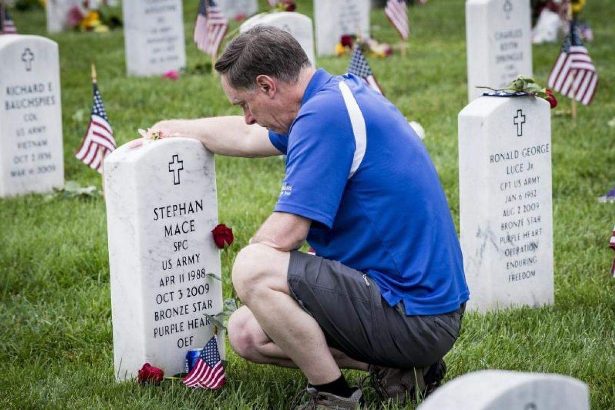 Mr Larry Mace visiting the grave of his son, US Army Specialist Stephan Mace, at Arlington National Cemetery on Monday (May 29). The section the specialist is in is the burial ground where military personnel killed in the global war on terror since 2