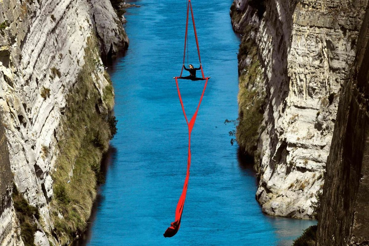 Greek choreographer and dancer Katerina Soldatou performs above the Corinth Canal, as part of the Greece Has Soul project on May 30, 2017 in Corinth. PHOTO: AFP
