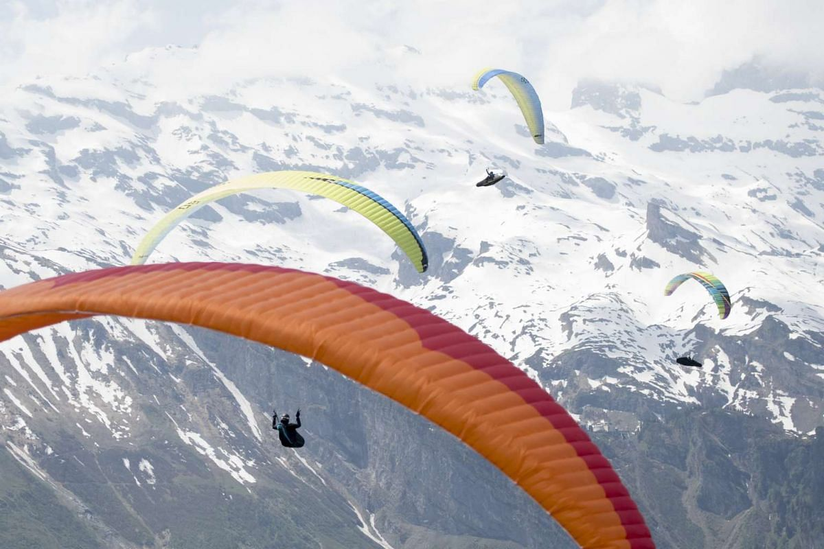 Participants from all over the world take part in the Swiss Open Paragliding Championships in Engelberg, Switzerland, May 30, 2017. PHOTO: EPA