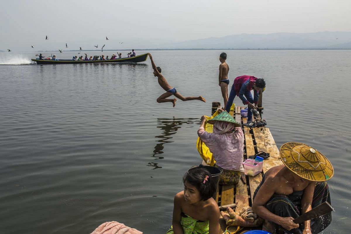 Ethnic Shan-ni villagers wash and bathe in the Indawgyi Lake.