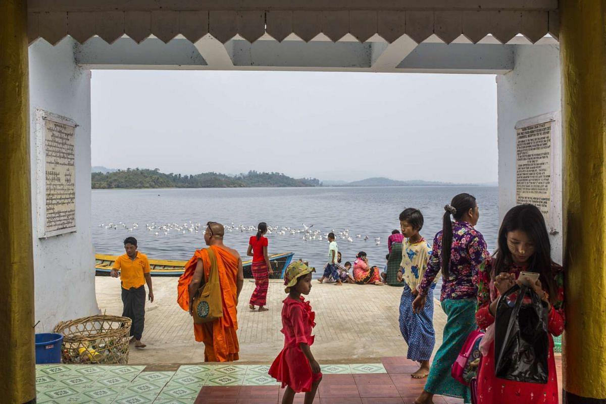 Pilgrims at Shwemyitzu Pagoda on Indawgyi Lake in Myanmar