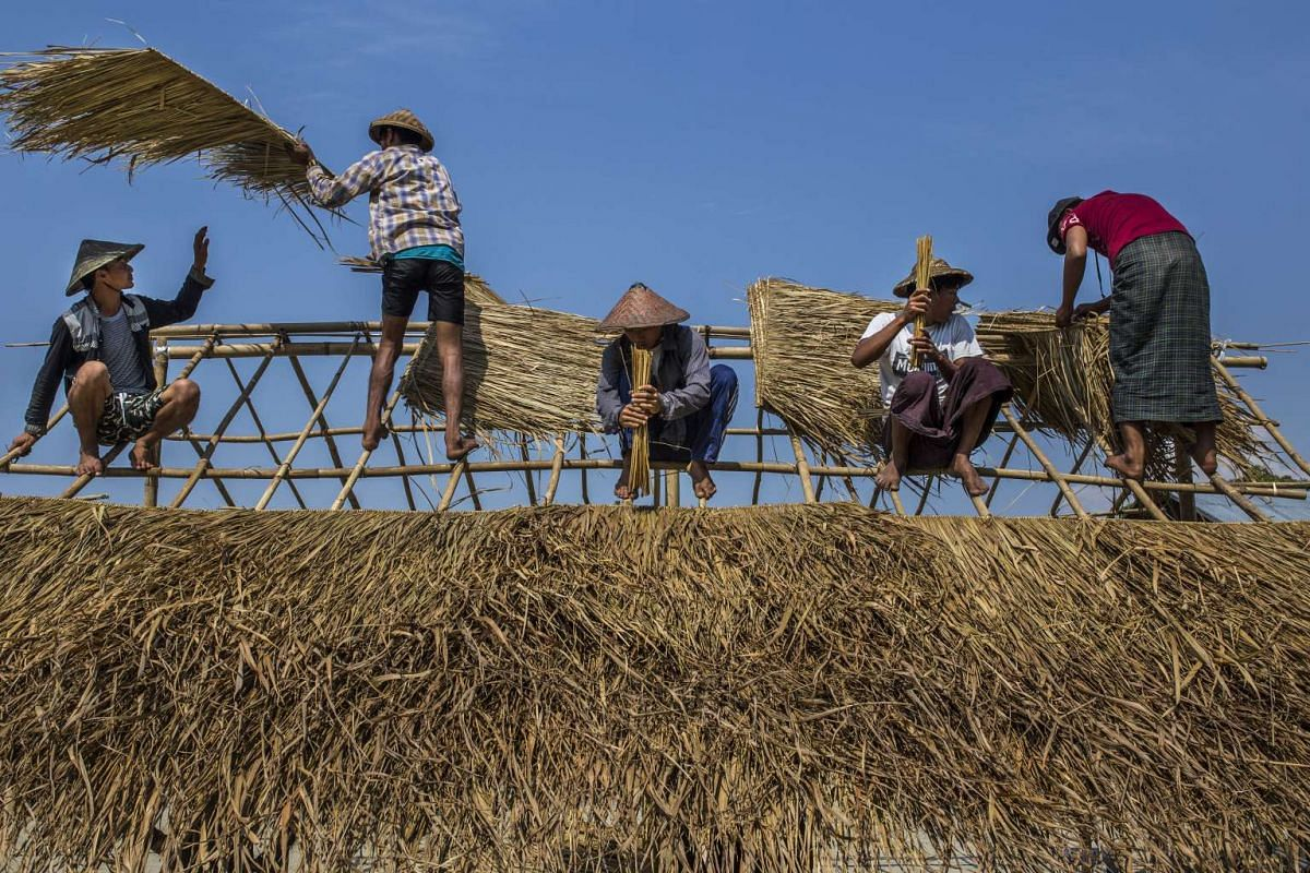 Villagers build a shop in preparation for the arrival of tourists, in Hepa village, on the east side of Indawgyi Lake in Myanmar.
