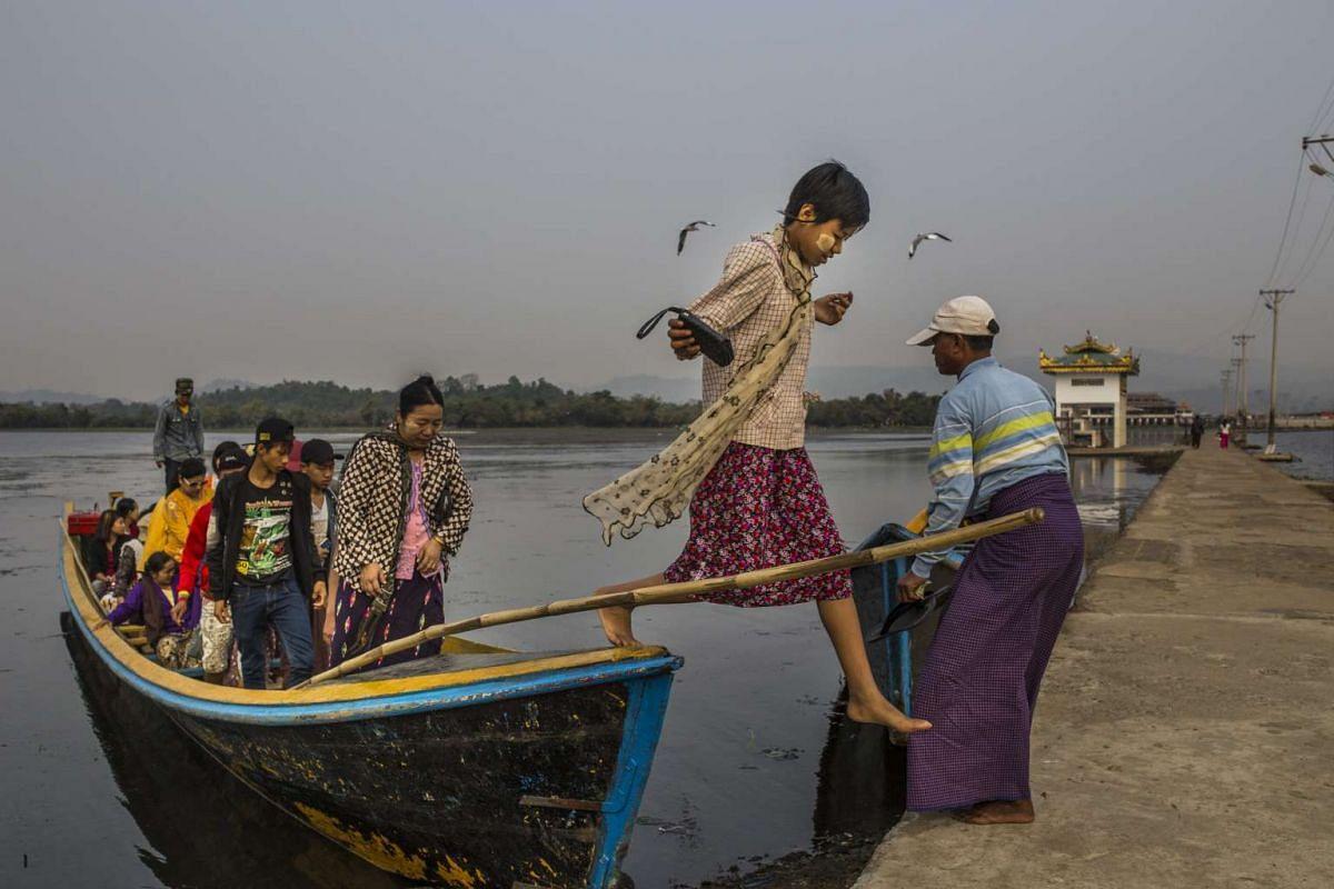 Pilgrims arrive at Shwemyitzu Pagoda on Indawgyi Lake in Myanmar.
