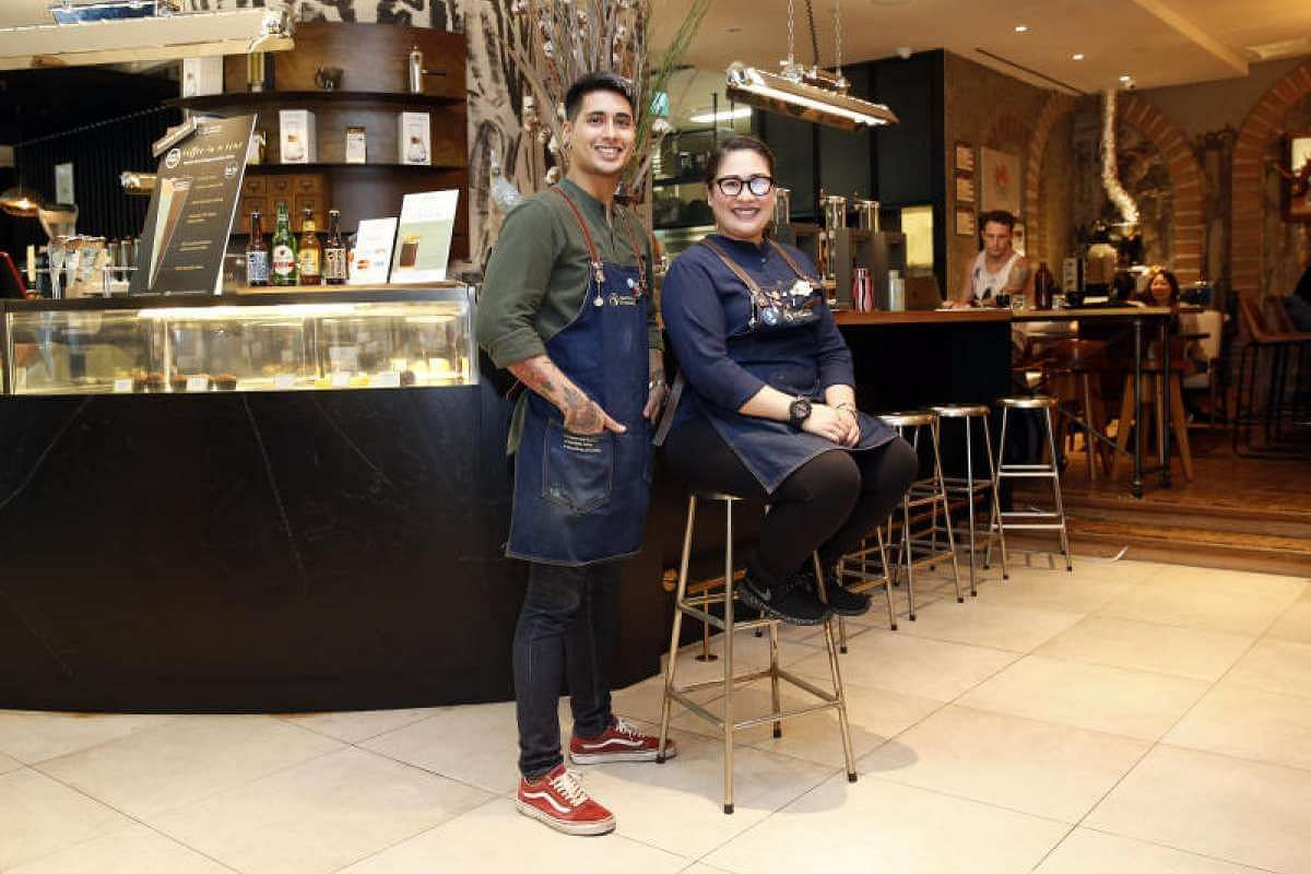 What senior barista Simargeet Singh and manager and head barista Vanessa Caceres (both above) like most about their uniform at The Coffee Academics at Scotts Square is that it helps them to project the right image.