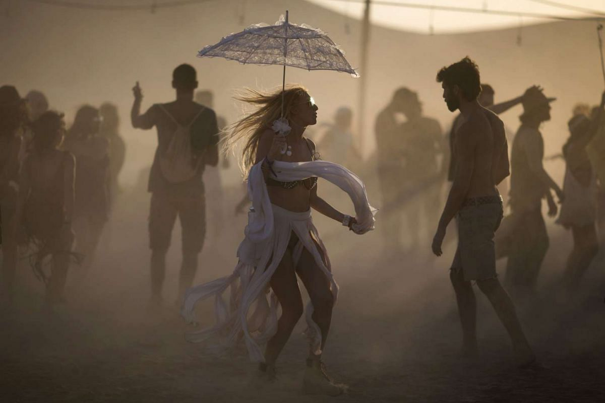 Festivalgoers dance during the Israel Midburn Festival in the Negev desert southern Israel May 31, 2017.