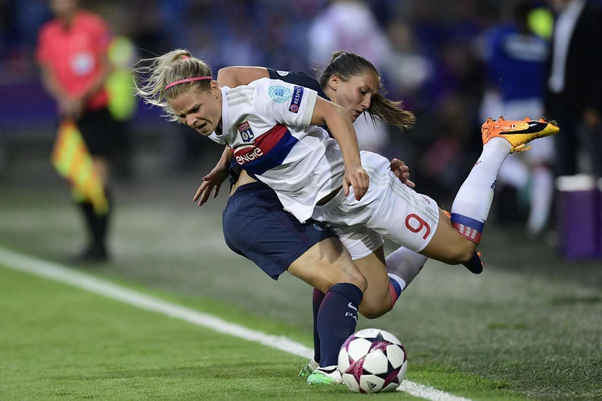 Paris Saint-Germain's French midfielder Eve Perisset (L) vies with Lyon's French midfielder Eugenie Le Sommer during the UEFA Women's Champions League final football match between Lyon and Paris Saint-Germain at the Cardiff City Stadium in Cardiff, s