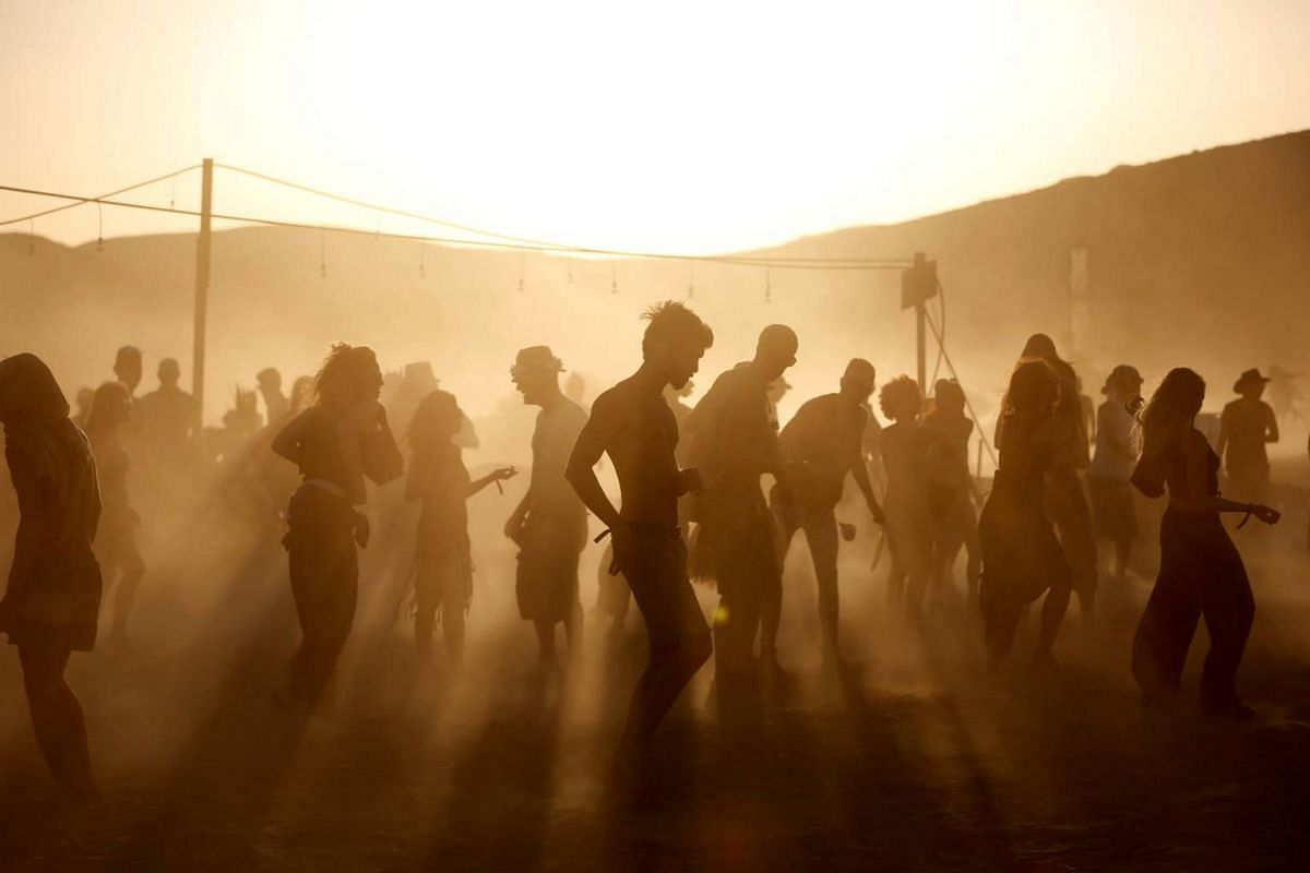 People take part in the Midburn, the Israeli version of Nevada's Burning Man festival, at southern Israel on May 31, 2017.