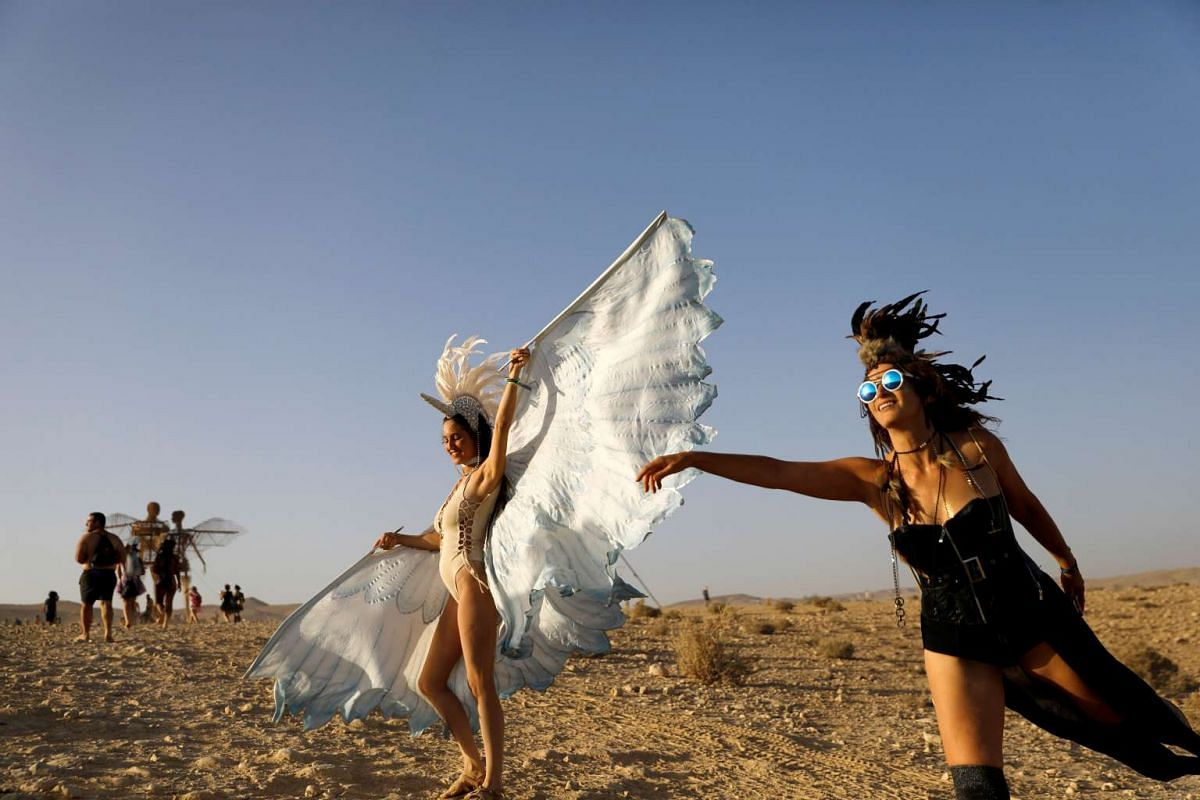 People take part in the Midburn, the Israeli version of Nevada's Burning Man festival, at southern Israel on May 30, 2017.