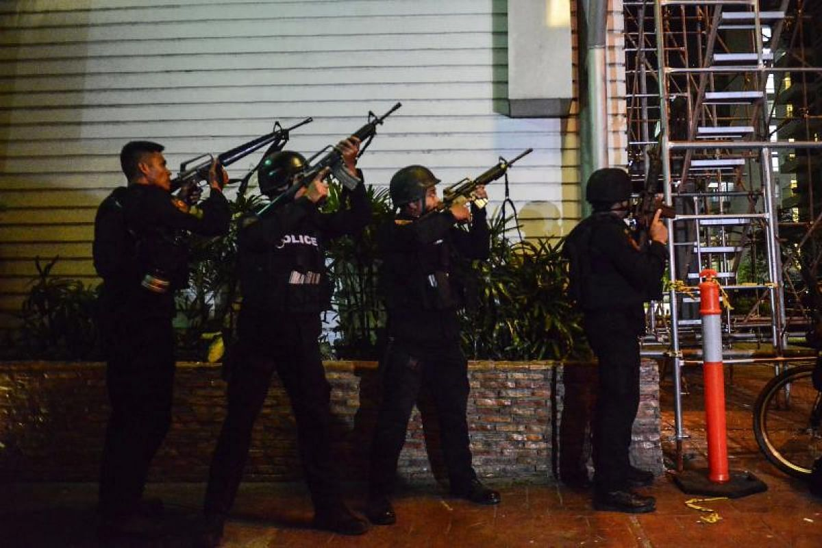 Filipino elite Police Special Weapons and Tactical (SWAT) personnel take their position outside the hotel.