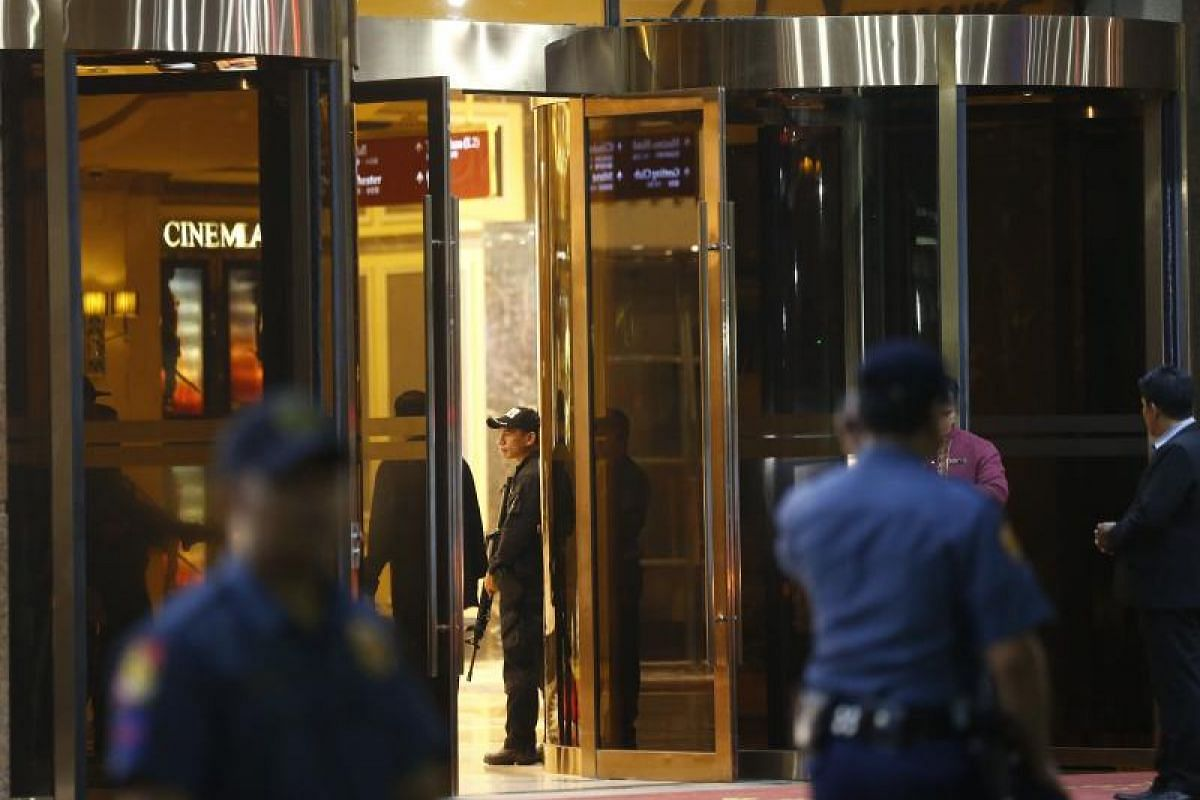Philippine police secure an entrance of the Resorts World Manila hotel and casino complex in Pasay City, south of Manila.