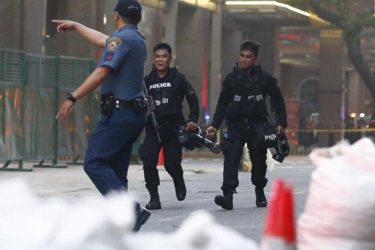 Philippine police secure the vicinity of the hotel.