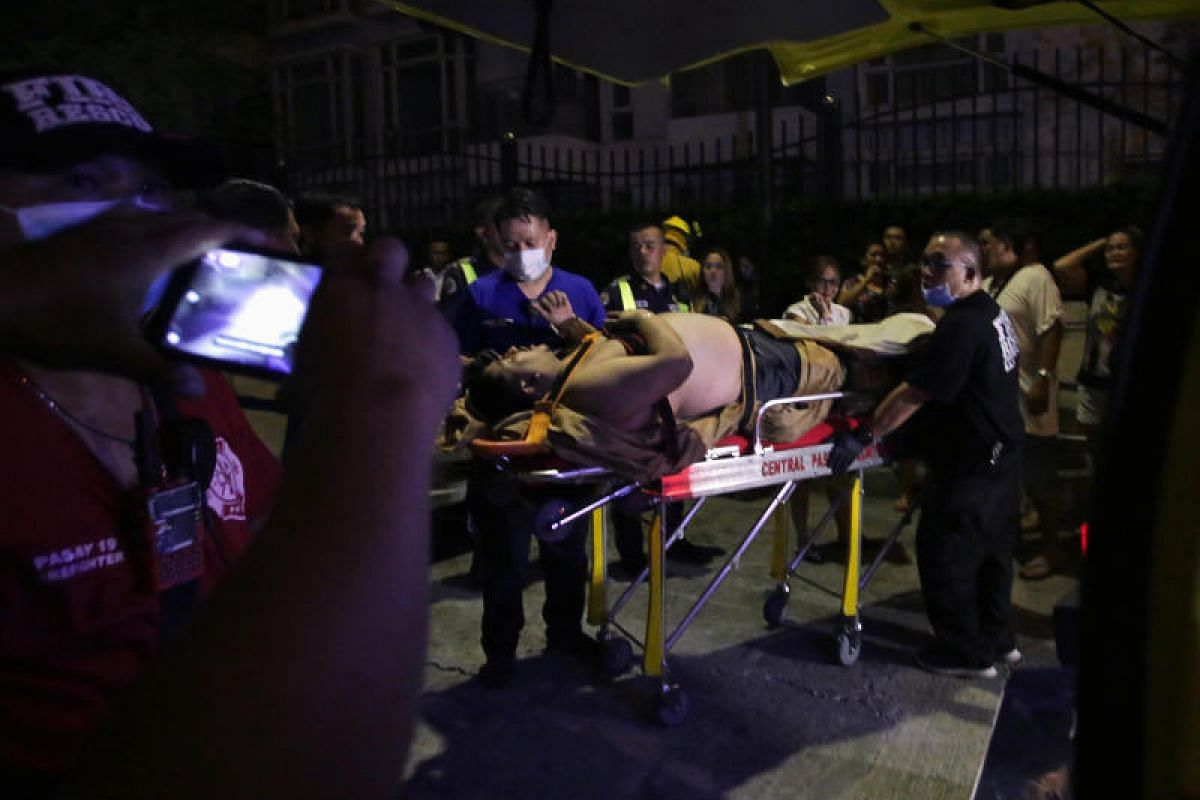 An injured hotel guest is seen outside of the hotel after the shooting incident.