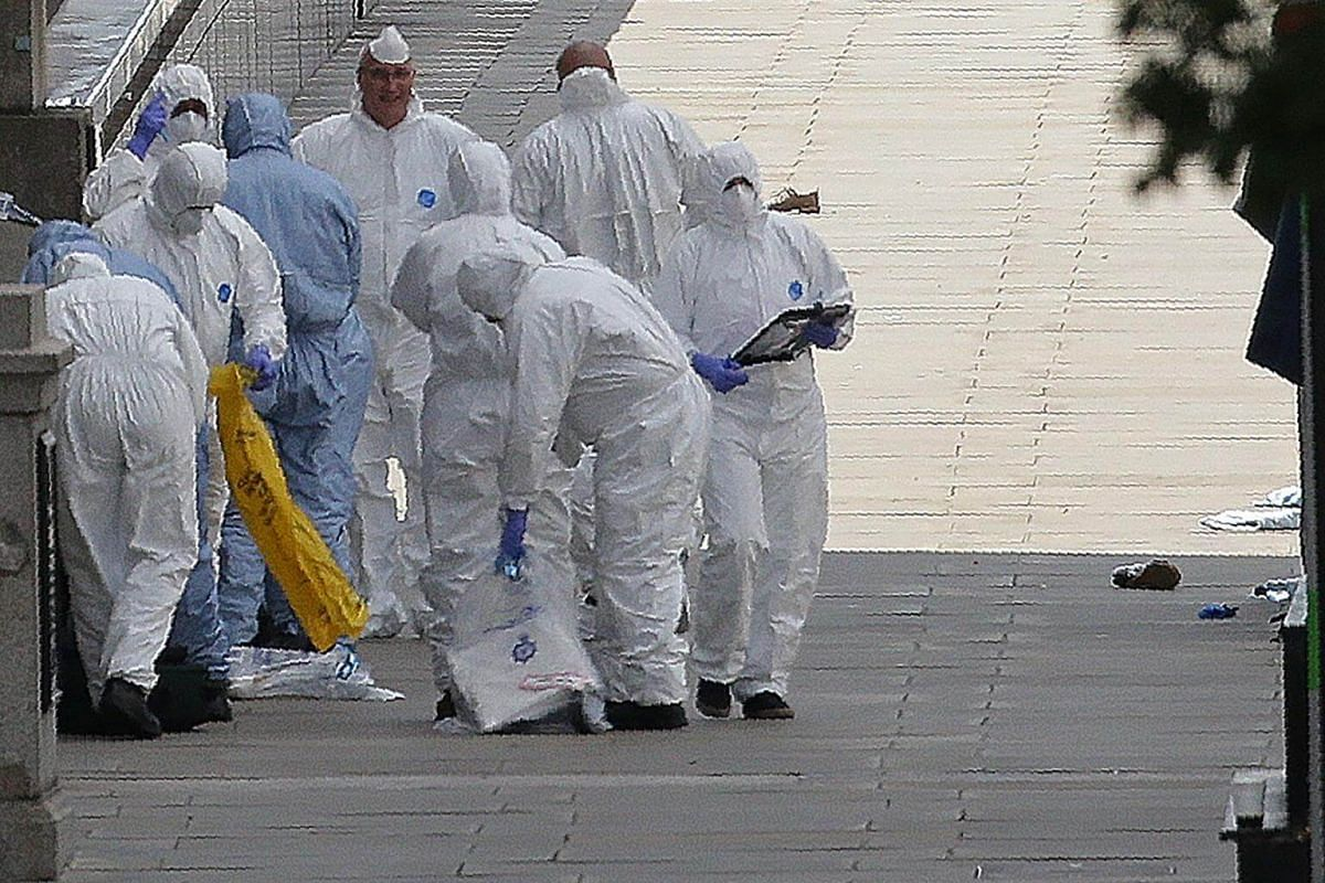 Forensic investigators working at the site of the attack, on London Bridge on June 4, 2017.