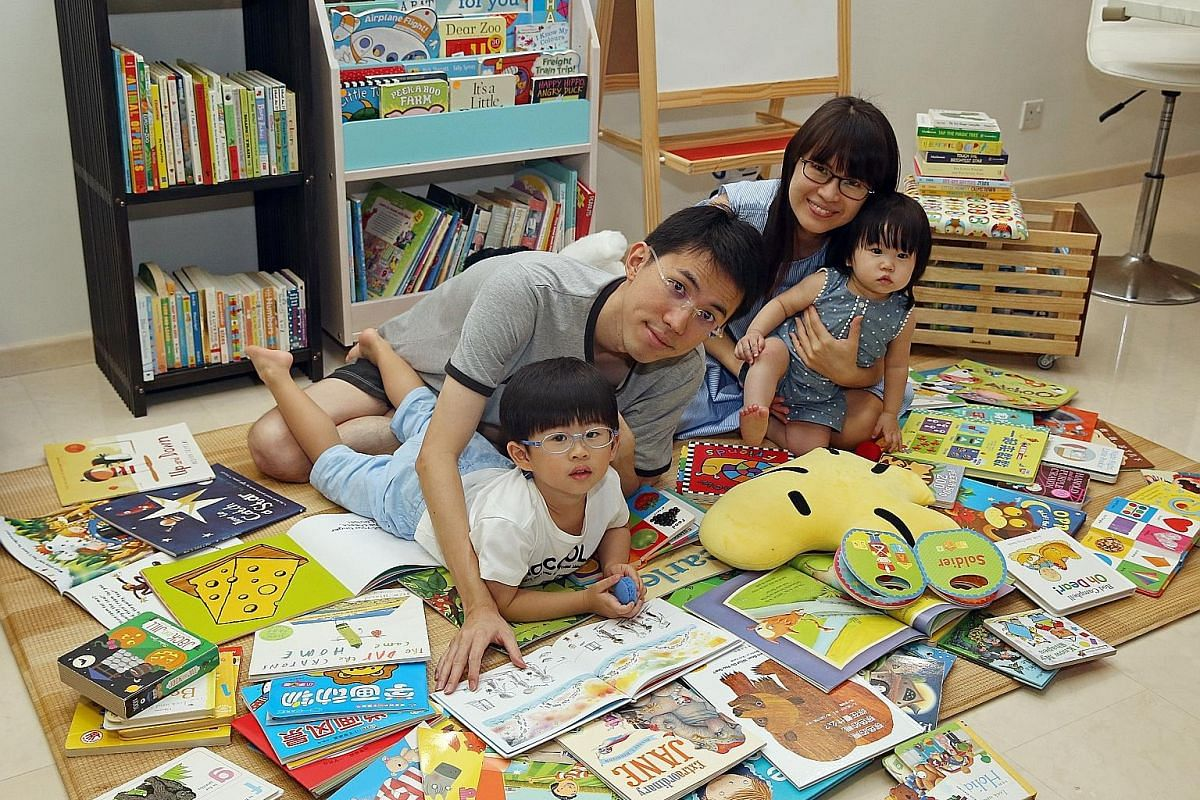 Mrs Tiffany Lim with her husband, Paul, 30, and children Chloe, three, and Joash, one. She has been buying books for her kids online in the past year. Mrs Melissa Lee with her husband Lee Chien Herr, 36, and their children Ryan, three, and Renee, one