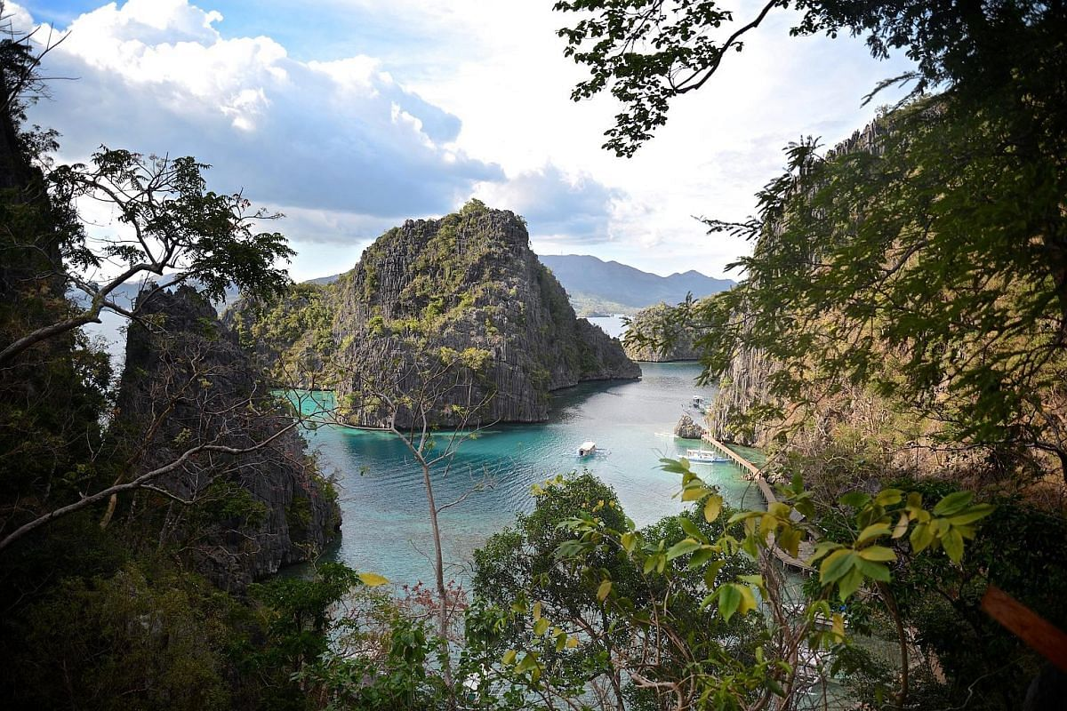 Kayangan Lake hides a cove with waters so clear the lakebed peers back like a greenish moonscape.