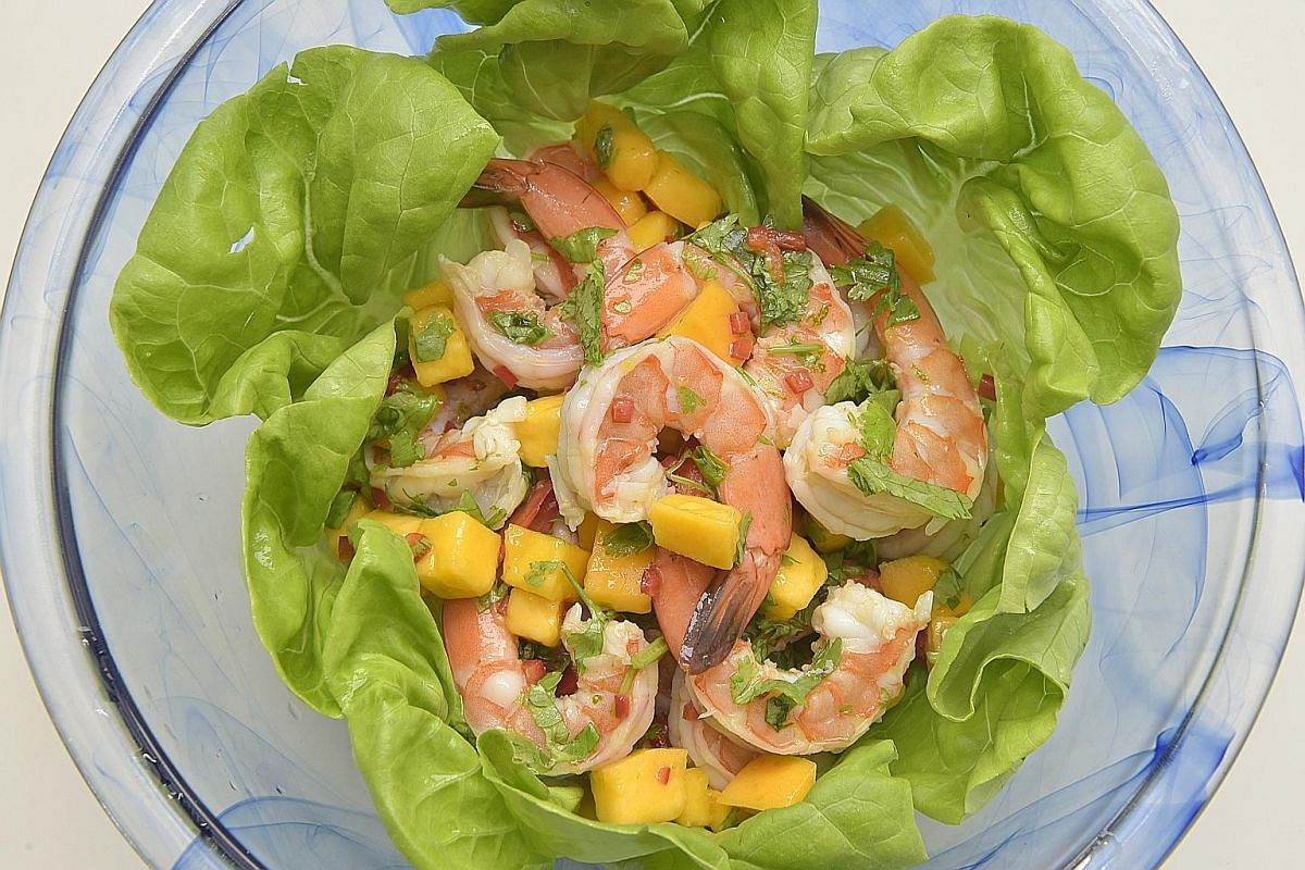 A dressing with lime zest and juice complements the mango and prawn salad.