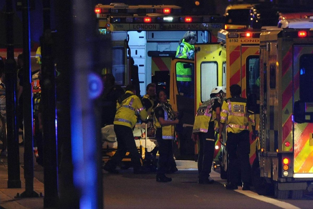 Members of the emergency services work at the scene of a terror attack on London Bridge in central London on June 3, 2017.