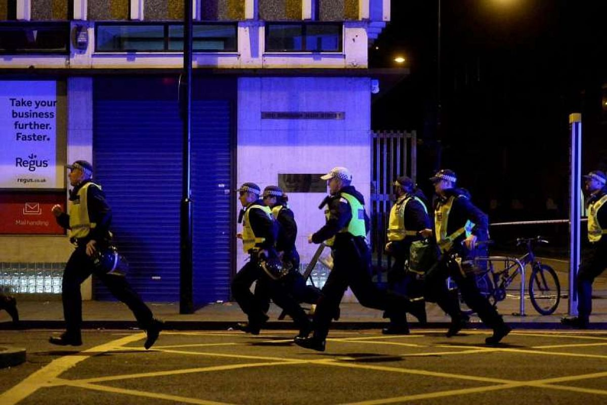 Police attend to an incident on London Bridge in London, Britain on June 3, 2017.