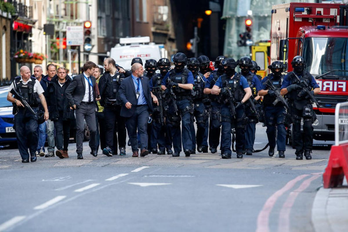 Armed police officers on Sunday (June 4)  patrolling streets in London near the scene of the terror attack.