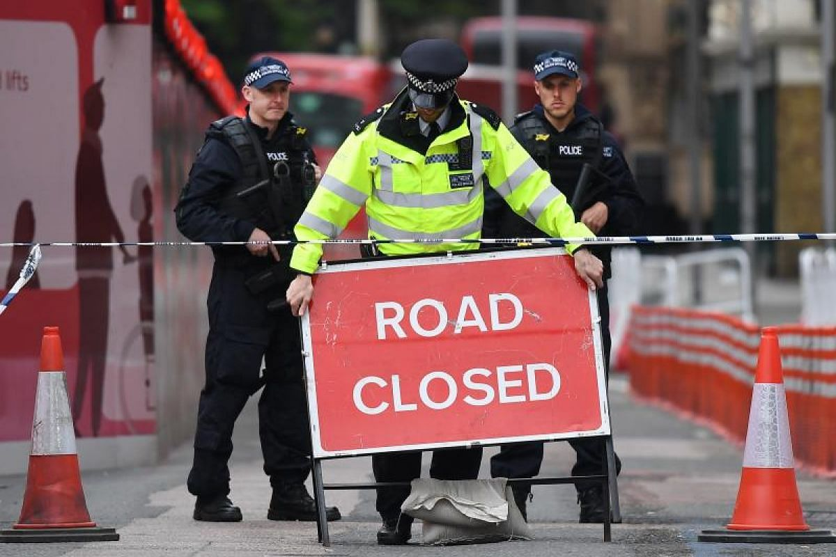 British armed police guarding a closed road near Borough Market on Sunday (June 4), in the aftermath of the attack the day before.
