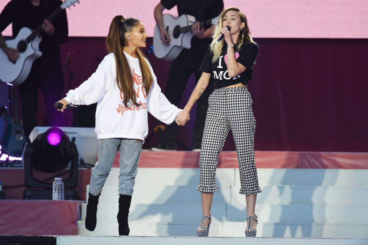 Ariana Grande (left) and Miley Cyrus performing on Sunday (June 4) at the One Love Manchester benefit concert for the victims of the Manchester Arena terror attack.
