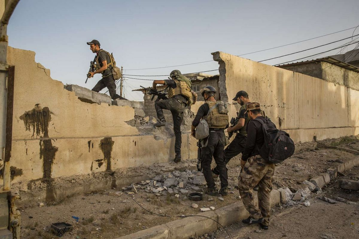 Iraqi special forces soldiers clear a school in the Saha neighborhood of Mosul, Iraq on May 27, 2017.