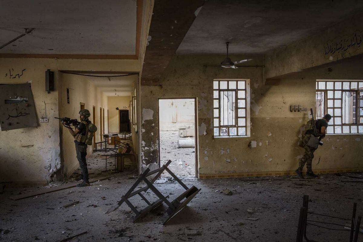 Iraqi special forces soldiers clear a school in the Saha neighborhood of Mosul, Iraq, May 27, 2017.