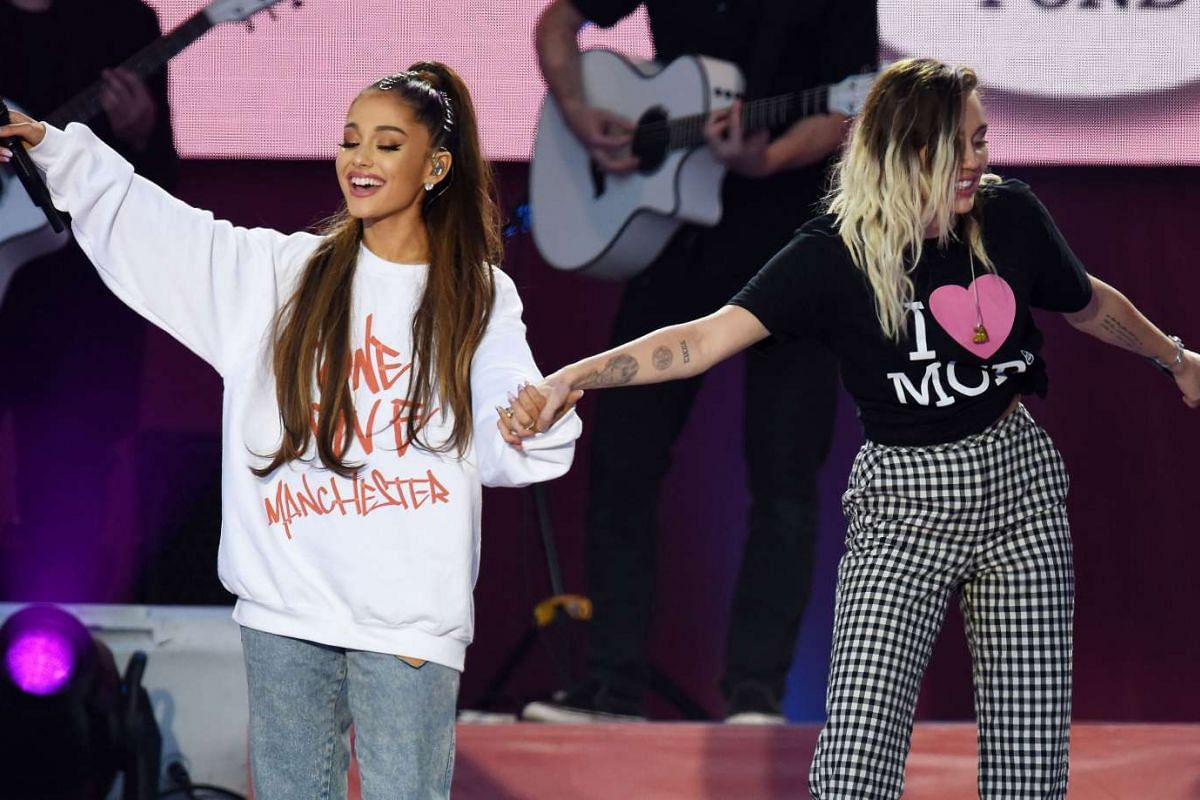 Ariana Grande (left) and Miley Cyrus perform during the One Love Manchester benefit concert on June 4, 2017.