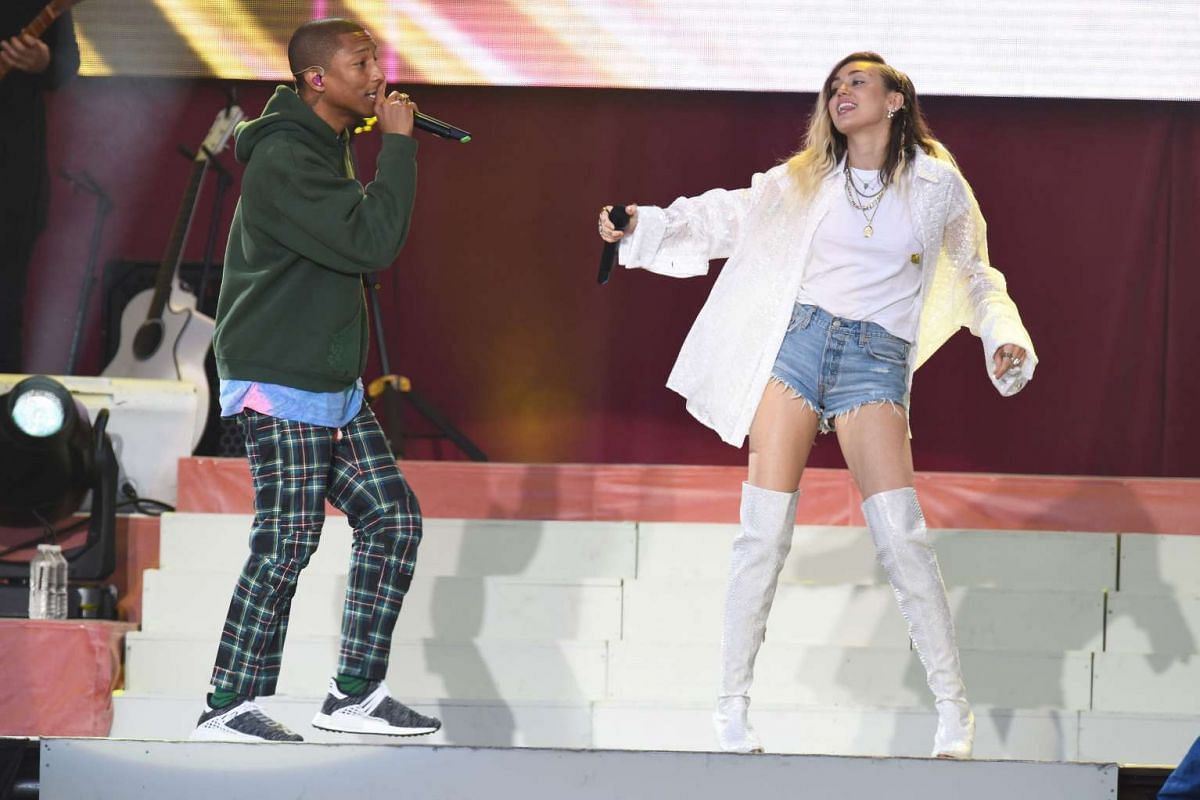 Pharrell Williams and Miley Cyrus perform during the One Love Manchester benefit concert on June 4, 2017.