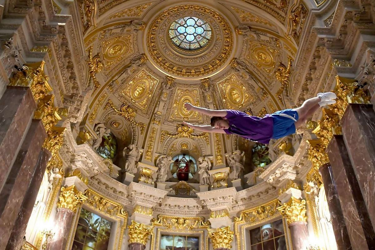 A man jumps on the trampoline during a service in the Berlin Cathedral on June 5, 2017 in Berlin. PHOTO: AFP