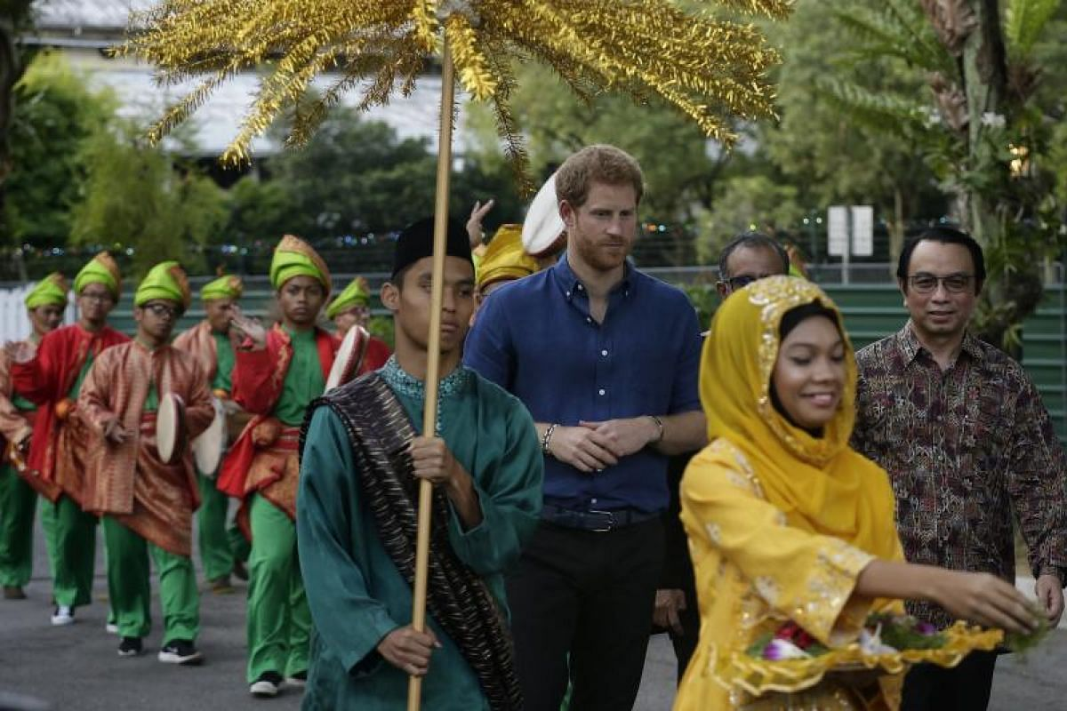 British Prince Harry receiving a traditional welcome, comprising 10 hand drummers, upon his arrival at Jamiyah Singapore on Sunday (June 4). He is accompanied by Jamiyah Singapore president Mohd Hasbi Abu Bakar.