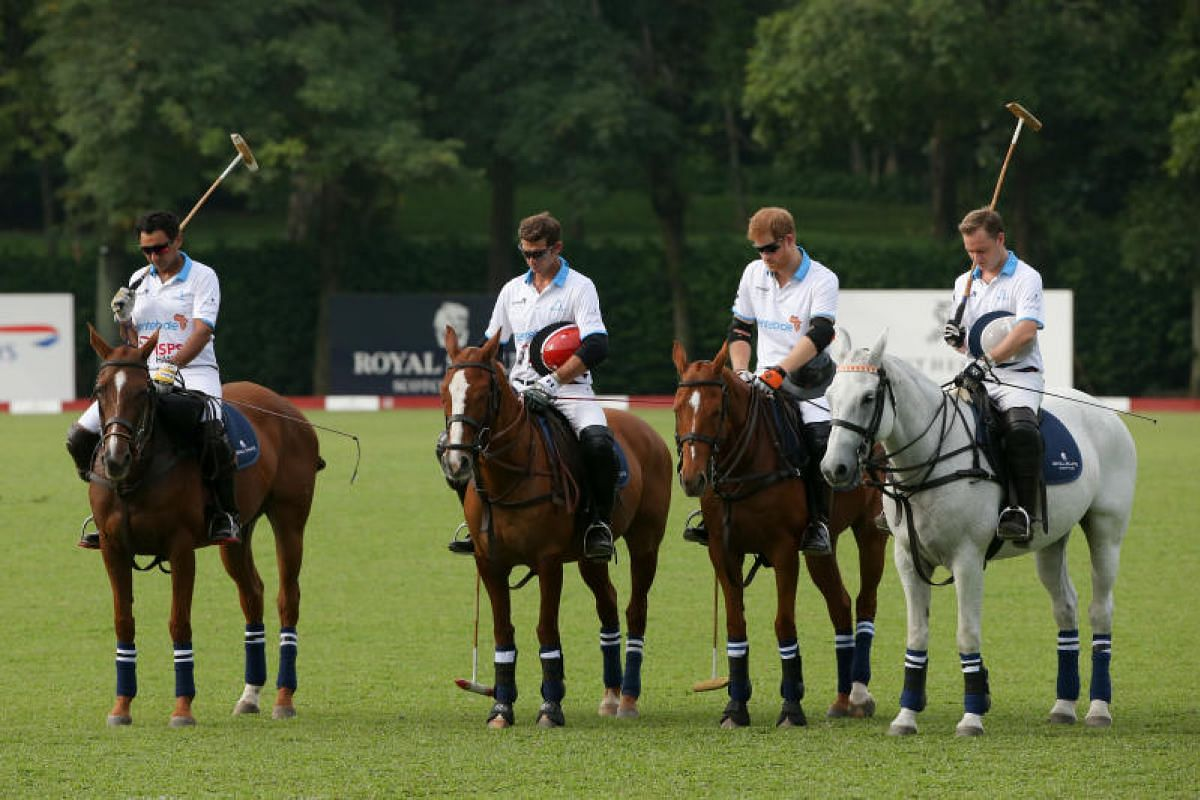 Prince Harry (third from left) and players at the Sentebale Royal Salute Polo Cup observing a minute of silence before their game on Monday (June 5). Their mark of respect was in remembrance of victims of last Saturday's terror attack in London which