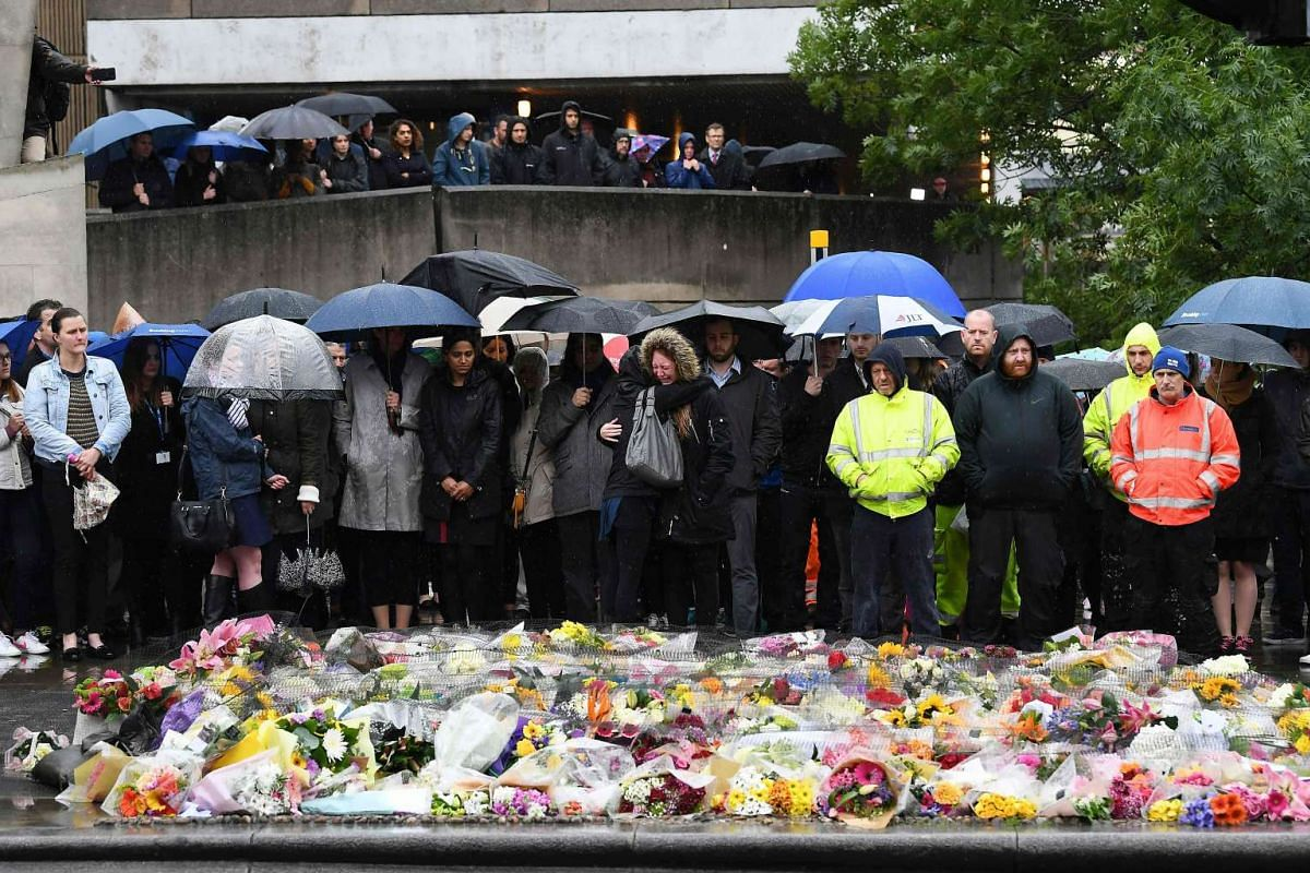 People observe a minutes' silence at south-side of London Bridge in London on June 6, 2017, in memory of the victims of the June 3 terror attacks. PHOTO: AFP