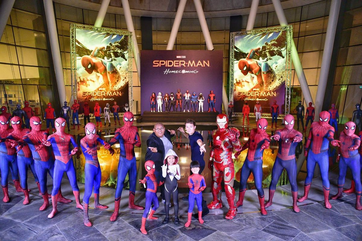 Tom Holland and Jacob Batalon posing together with the local movie Spider-Man fans after the Spider-Man movie red carpet.