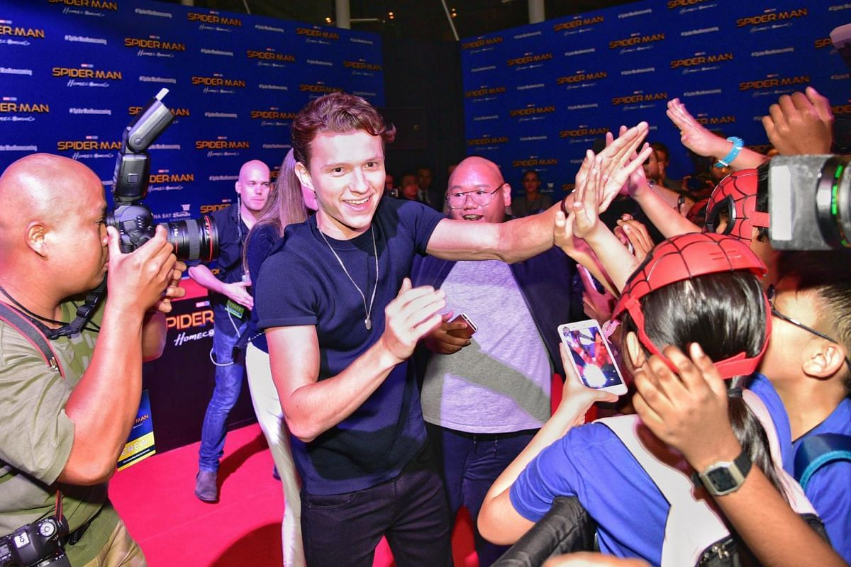 Tom Holland and Jacob Batalon greeting the fans at the Spider-Man movie red carpet.